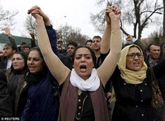 Brave: Female members of civil society organisations take part in a protest in central Kabul this morning to condemn the killing of 27-year-old woman Farkhunda