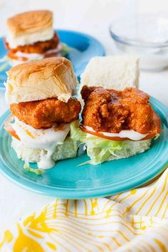 We've been making boneless buffalo chicken fingers for ages, and it's one of my husband Curtis' most favorite dinners. One day, he suggested we make sliders. To be honest, I made them a few times in t Buffalo Chicken Fingers, Buffalo Chicken Sliders, Beef Sliders, Turkey Burgers, Veggie Burgers, Tapas, Pollo Buffalo, Pioneer Woman Recipes, Pioneer Women