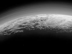 PHOTO: Pluto's Majestic Mountains, Frozen Plains and Foggy Hazes: Just 15 minutes after its closest approach to Pluto on July 14, 2015.