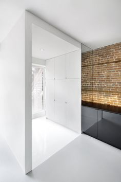 Espace St-Denis is the design of a sq. condo, located on the ground floor of a triplex in Montreal. It has been designed by Anne Sophie Goneau Design. Interior Design Magazine, Residential Interior Design, Interior Architecture, Floor To Ceiling Cabinets, Appartement Design, Brick And Wood, Brick Wall, Interior Minimalista, Apartment Renovation