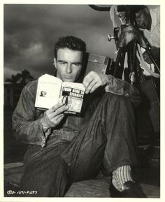 FROM HERE TO ETERNITY - Montgomery Clift reads the best-selling novel which will soon be directed by Fred Zinneman.
