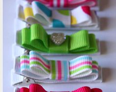 Set of five Belle's Bows Flat clips coral / pastal