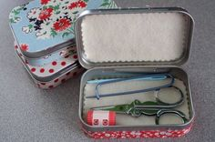 Fabric covered Altoid tins serving as miniature sewing kits, even holds wee scissors!