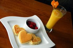 """We had such a great time with our original """"Fun with Food"""" day, that I decided to do it with a Valentine theme. Breakfast – Heart Pancakes, Raspberries and Orange Juice Lunch – Tomato Soup with Heart Shaped Toasted Cheese Snack – Pretzels, Raspberries, Heart Shaped Kiwi and Satsuma Dinner – Spaghetti with Heart Shaped Parmesan Crisp I also wanted to include a picture of how I did the Parmesan… {Read More}"""