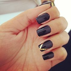 simple black with gold triangle stripe nails