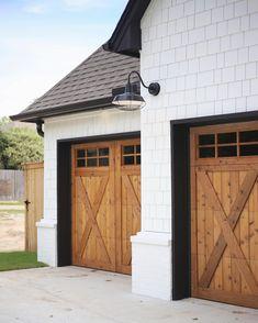 Home Renovation Garage wood rustic farmhouse Garage doors, white siding, black roof