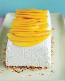 Coconut-Lime Semifreddo 1 can (13.5 ounces) unsweetened coconut milk 1 can (14 ounces) sweetened condensed milk 1 tablespoon finely grated lime zest (from 2 limes) 1/4 teaspoon coarse salt 1 1/2 cups cold heavy cream 1/2 cup sweetened shredded coconut, toasted 1/2 ripe mango, thinly sliced COOK'S NOTE  In place of mango, you can use thinly sliced fresh pineapple as topping