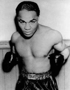 Henry Armstrong Jr. - 150 wins, (100 KO) 21 losses, and 9 draws. Boxing Era: 1931-1945. The first and only boxer to hold 3 world championship division titles at the same time.