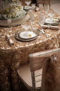 Orange County Ceremony Magazine Tabletop Inspiration | Champagne Rain  May 2nd, 2012~ I look at this and find it beautiful and then I think of a guest who has imbibed to much catching the base of the glass in the ruffles so that the table is covered in wine.....