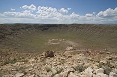 Meteor crater - A group of workers have successfully excavated a humongous meteorite out of the ground located in Campo del Cielo about 670 miles northwest of Buenos Aires, Argentina. The meteorite, which is estimated to weigh 30 tons, is believed to be one of the meteorites that hit the earth 4,000 to 4,700 years ago.