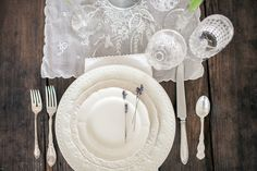 Rent from Southern Vintage to create this rustic elegance wedding table- antique farm table,  vintage linen runners,  ivory china, silver stemware and clear stemware, Kaitie Bryant Photography
