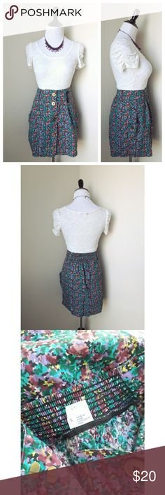 {urban outfitters} floral skirt A charming and pretty floral skirt from Urban Outfitters   Brand is Cooperative  Features large gold buttons, pockets, and a ruched back for the perfect fit  Girly, cute and fun!   Gently worn Size  small Urban Outfitters Skirts