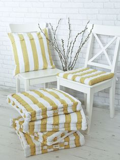 Stripes are so summery and chilled that you'll want these neat ochre yellow cushions in every cosy corner of your house.