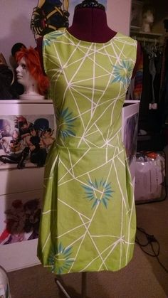 Just finished my Joy dress for my Inside Out cosplay! Was a long project but i'm quiet happy with the results<3 I hand painted each line on both the top n skirt.  Made the flower patterns out of left over iron on numbers from my haikyuu cosplay and painted them with fabric paint.