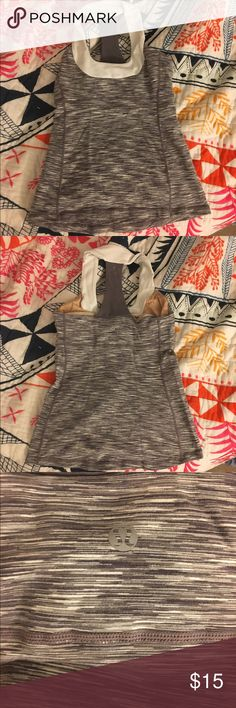 Heathered Grey Lulu top Heathered gray top by Lululemon not sure the size as it's been born at four but literally in mint condition I would say it's a size 6 or size 8 I'm 511 150 pounds and it fits me it is clearly a Lululemon please do not negotiate price as I will not except thank you lululemon athletica Tops Tank Tops