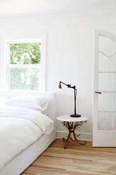 all white bedroom with vintage bedside table and lamp. / sfgirlbybay