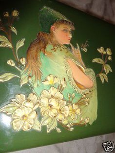 This is the actual box on page 138 and it is plate number The box is 11 by by 4 All I see to note is a small back side bottom corner chip, fraying to lining and an odd white spot on lining in the lid. Is 11, Cherries, Blossoms, Art Nouveau, Dresser, Lady, Painting, Maraschino Cherries, Flowers