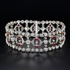 A rare and majestic Belle Epoch bracelet glistening with carats of old mine-cut (plus a few rose-cut) diamonds, and highlighting a double row of ravishing red Burmese rubies totaling carats. This extraordinary Edwardian bracelet is crafted in p Edwardian Jewelry, Antique Jewelry, Vintage Jewelry, Ruby Bracelet, Diamond Bracelets, Jewelry Bracelets, Bangles, Best Diamond, Simple Earrings