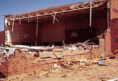 The Starr Elementary School Auditorium completely collapsed showing that   any free span auditorium structures are unsafe in a tornado.  Image by Ken Dewey, School of Natural Resources, UNL