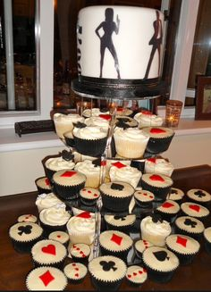 007 themed cake and cupcakes