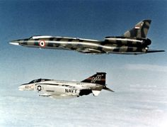 "A U.S. Navy McDonnell F-4N Phantom II from Fighter Squadron VF-51 Screaming Eagles intercepts a Soviet-built Libyan Tupolev Tu-22 ""Blinder"" over the Mediterranean Sea, in April 1977."