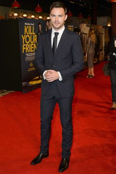 """""""Nicholas Hoult shows you why a black suit will never go out of style - GQ.co.uk"""""""