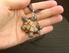"The back of the ""Volcano"" turtle necklace by Pyro Helfier."