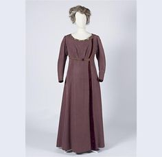 Reform-style dress, ca. 1910, of purple wool with wooden beads and purple velvet with embroidery around the neck and (high) waist.