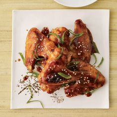 East-Meets-West Wings: Nick Podesta and Jason Freiman put an Asian spin on chicken wings, the all-American bar snack, by coating them in a sweet-spicy-sticky glaze made with brown sugar, soy and chile sauces, chopped ginger and scallions. Food Network Recipes, Wine Recipes, Great Recipes, Cooking Recipes, Favorite Recipes, Asian Recipes, Delicious Recipes, Sriracha Chicken, Sesame Chicken