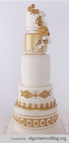 Indian Weddings Inspirations. Gold cake. Repinned by #indianweddingsmag indianweddingsmag.com