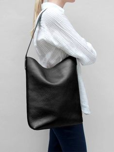 Minimal leather bags, backpacks, tote bags and purses. Handmade in England, Shipped Worldwide.