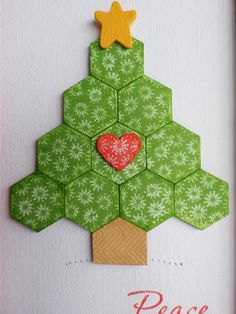 close-up view of framed deco from stamping and stitching: Hexagon Christmas Tree ... could be emlated in paper for a card ... luv the little heart at the center ...