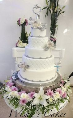 My latest wedding cake, just white and silver with gumpaste...