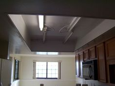 what to do with that 1980 s style kitchen lighting, kitchen design, lighting, Lighted grid drop ceiling removed