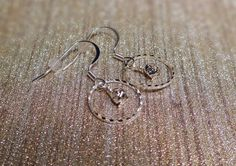 Check out this item in my Etsy shop https://www.etsy.com/listing/487095343/rhinestone-silver-hoop-earrings-silver