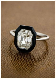 An antique engagement ring with a 2 carat center diamond in an onyx surround. Art Deco; circa 1920s.