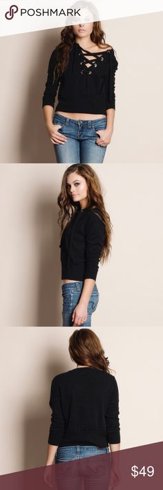 """Lace Up Sweater Top Lace up sweater top. Available in black and olive. This listing is for the BLACK. This is an ACTUAL PIC of the item - all photography done personally by me. Model is 5'9"""", 32""""-24""""-36"""" wearing the size small. NO TRADES DO NOT BOTHER ASKING. 70% polyester 25% rayon 5% spandex Bare Anthology Tops Tees - Long Sleeve"""