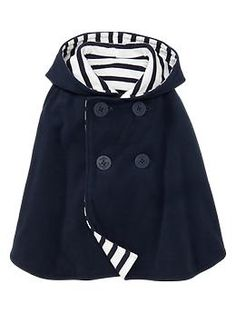 Reversible fleece poncho. Gap...try to make this? I need this for Aven it is so much practical because I always struggle putting on his jackets especially if he is sleeping this one i just throw it over him and even has a hood to cover his little head from wind