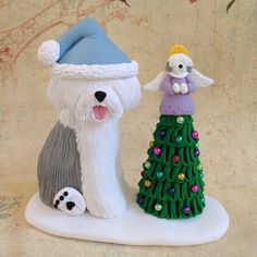 Old English Sheepdog clay Christmas figurine by Ginny Baker