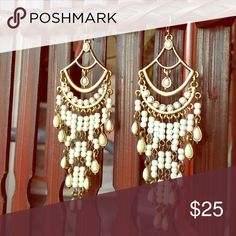 Lucky brand chandelier earrings Beautiful gold tone cream stone dangle earring with scroll pattern on the back side. I have used them maybe twice. It will be sanitized before being shipped :) Lucky Brand Jewelry Earrings