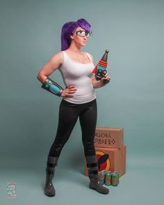 Leela Futurama Cosplay. Ray gun by Keroga Forge. Photo by Lucky Monkey Photography. Everything else made by Holly Brooke.