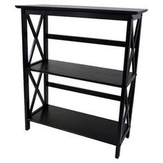 """Solid wood bookcase with lattice siding.  Product: BookcaseConstruction Material: Wood  Color: BlackFeatures: Three shelvesDimensions: 33.5"""" H x 29.5"""" W x 12"""" DCleaning and Care: Wipe with a damp cloth"""