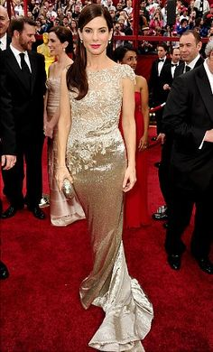 Beautiful dress - but I just can't help but picture the freight train coming at her, a gazillion miles an hour with Jesse James and that skanky, scary thing at the helm.  Talk about the agony and the ecstasy.  Horrid.    Oscars fashion: Best Academy Awards red carpet gowns of all time - NY Daily News