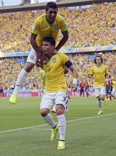 FIFA World Cup 2014 - Brasil 2 Colombia 1 (7.4.2014) Brazil's Thiago Silva, bottom, celebrates with Paulinho after scoring the opening goal during the World Cup quarterfinal soccer match between Brazil and Colombia at the Arena Castelao in Fortaleza, Brazil, Friday, July 4, 2014. Manu Fernandez / AP