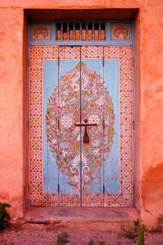 Peach and blue doorway - love this colour scheme for nursery