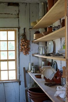 idea for simple shelving in garden room over potting bench