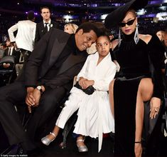Born to rule: Having skipped the red carpet, music's first family sat front row, with Blue sandwiched between her parents