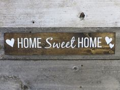 This handmade sign is created out of 3.5 x 18 x .75 pine and stained walnut. Home Sweet Home design is hand painted in white. It is then