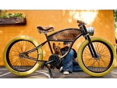 "Jay Allerton of Mode Bikes in Costa Mesa with shop dog Dorothy. Allerton says he was ""designing vintage-style bikes before vintage became popular."" He is pictured with a custom bike inspired by early-1900s motorcycles."