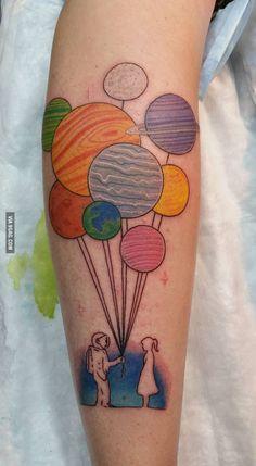 This guy got himself an interesting planetary tattoo - 9GAG